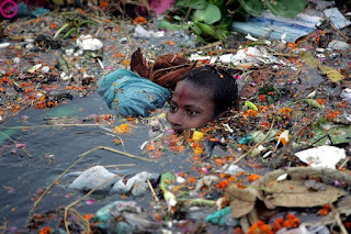 kid swimming in a polluted river