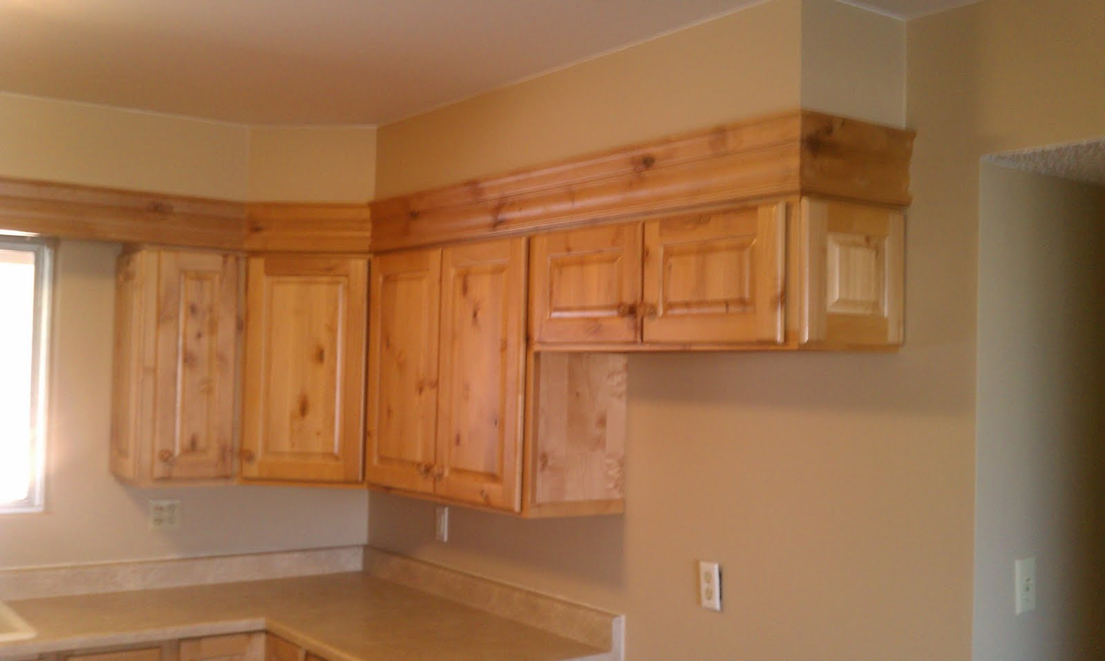 Goodwinmillandcabinet december 2011 for Oak crown molding for kitchen cabinets