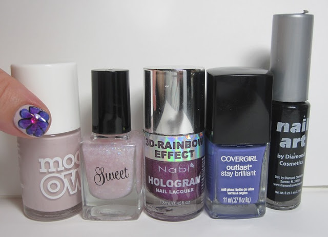 Bottle shot:  Models Own Utopia, SweetHeart Polish She's So Flakey, Nabi Hologram Purple, Covergirl Outlast Vio-last, and black nail art striper.