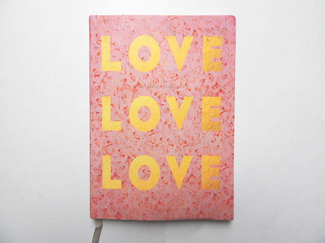 Pink notebook with roses on it cover reading LOVE LOVE LOVE in gold