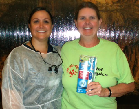 March raffle winner Mary H. with Rio Salado Dental Hygiene student Rachel E.