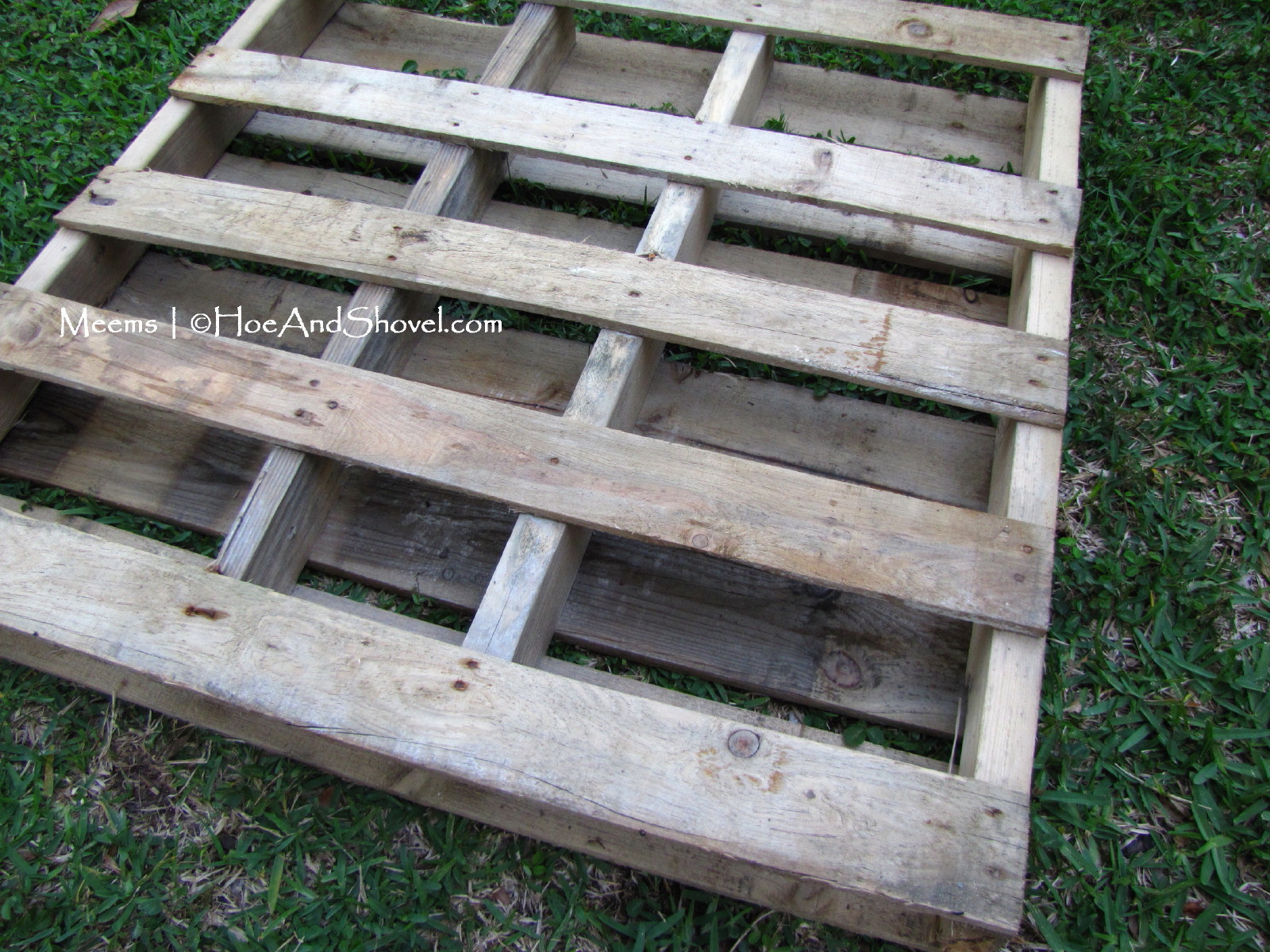 Hoe and shovel upcycled wooden pallet garden art for Pallet fire pit