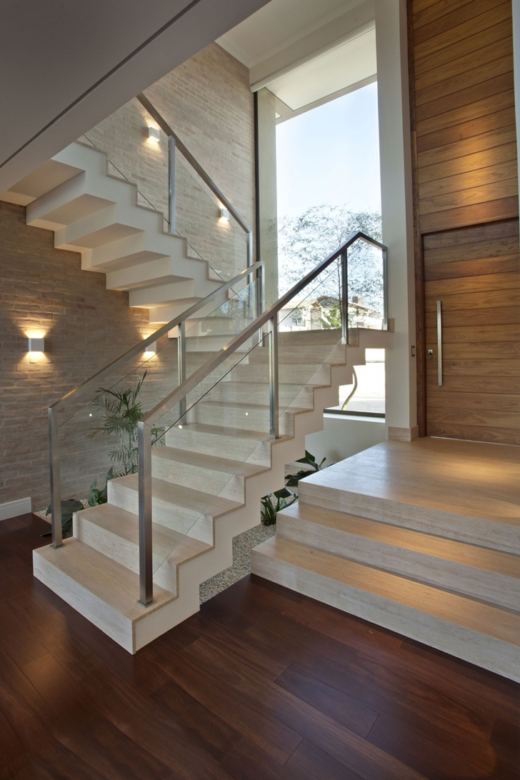 Modern stairs in Elegant dream home in Sao Paulo by Pupo Gaspar Arquitetura