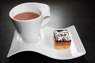 Cup of tea and a slice of millionaire's shortbread