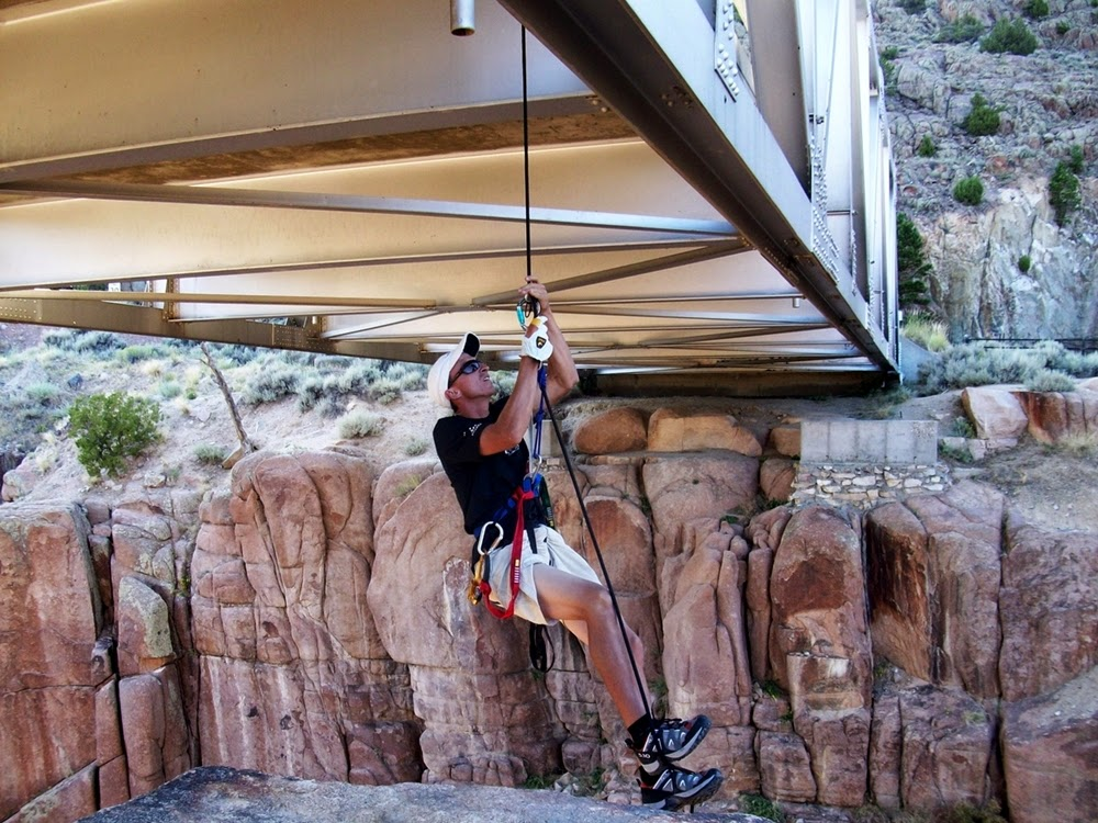 Druce Finlay practicing rope ascension under Fremont Canyon Bridge