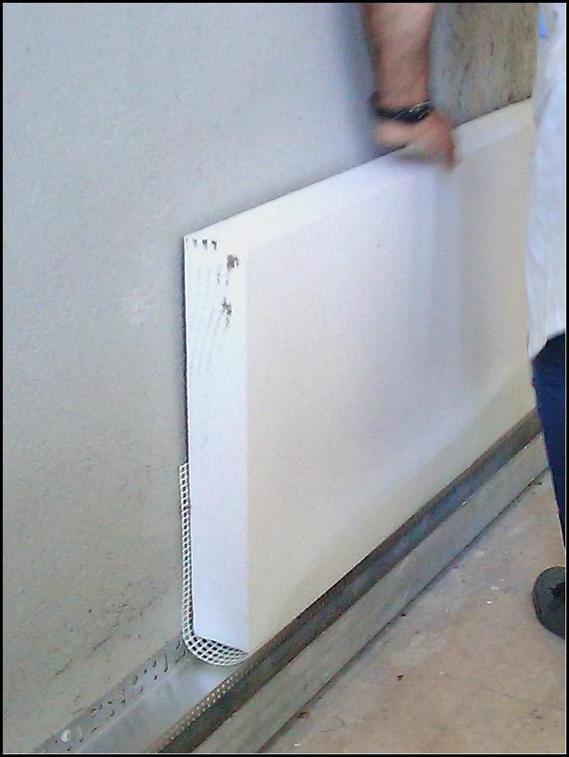 Colocação-da-rede-na-face-inferior-das-placas-de-EPS-pintar-a-casa