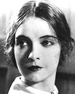 Vintage black and white photo of actress Lillian Gish.