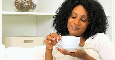Black woman drinking coffee