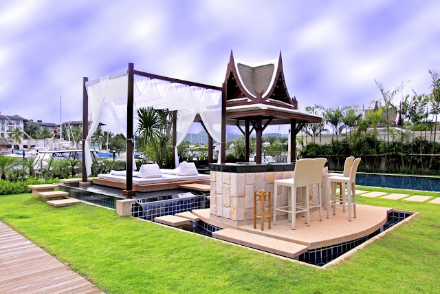 Picture of the private outdoor bar and bed above the pool in the backyard