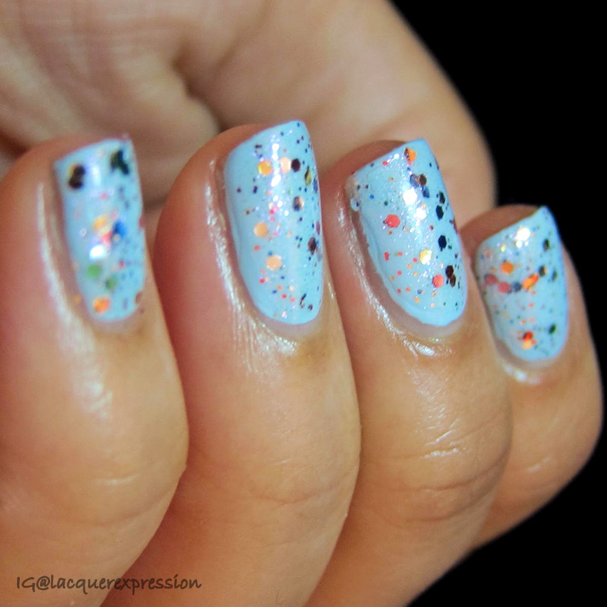 swatch of glitterbomb nail polish by orly
