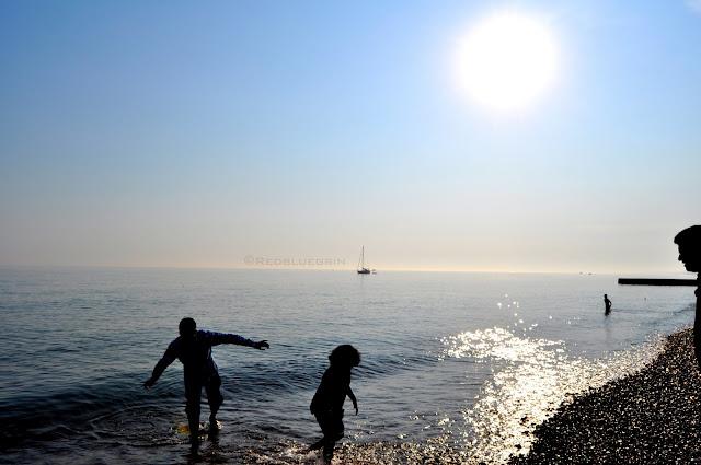 People enjoying the summer at Brighton beach, Brighton, UK