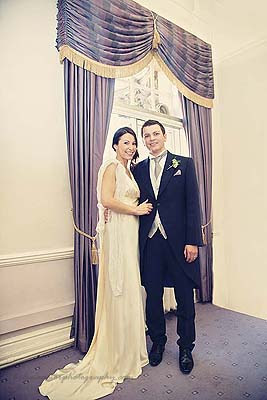 bride and groom in the purple room at Marylebone Town Hall wedding