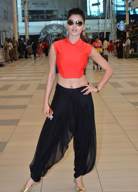 Urvashi Rautela Shows Off Navel Piercing in Dhoti Pants and Orange Crop Top