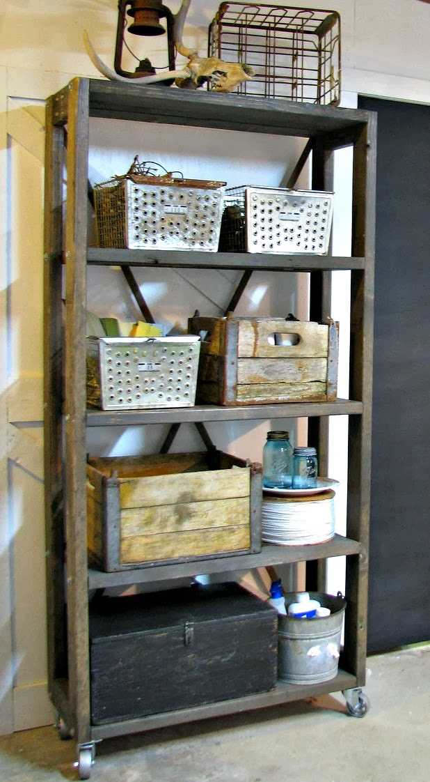 My Inspiration Came From The Restoration Hardware Rolling Storage Shelf  Found Here. I Modified The Dimensions To Suit My Needs.