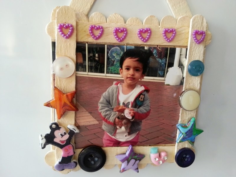Saachi And Me Made This Cute Simple Photo Frame With Ice Cream Sticks Embellished It Buttonsit Now Adorns Our Fridge A Pic Of Little