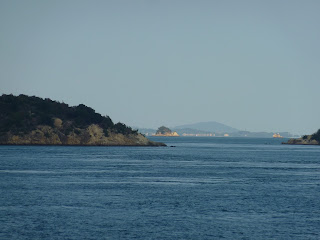 Islands in Seto inland sea taken from a ferry travelling from Naoshima (Miyanoura)  to Uno. Uno is in the background.