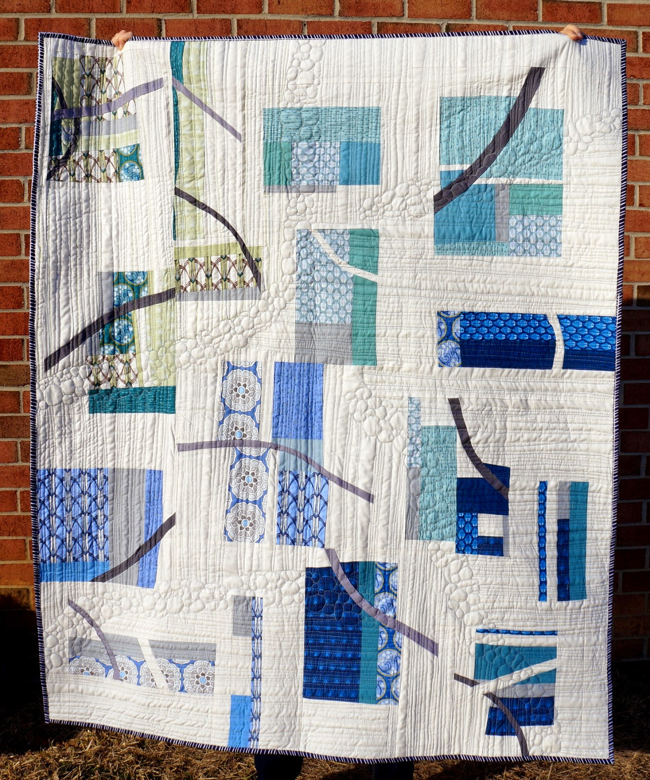http://quiltyhabit.blogspot.com/2015/03/pebble-cascade-finished-quilt.html