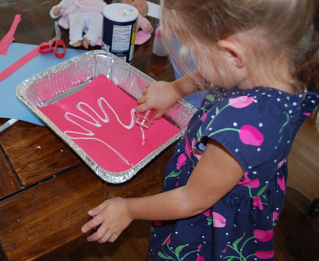 Preschooler doing artwork with her own hand