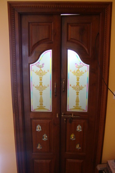 Carpenter work ideas and kerala style wooden decor pooja room door frame and door designs - Pooja room door designs in kerala ...