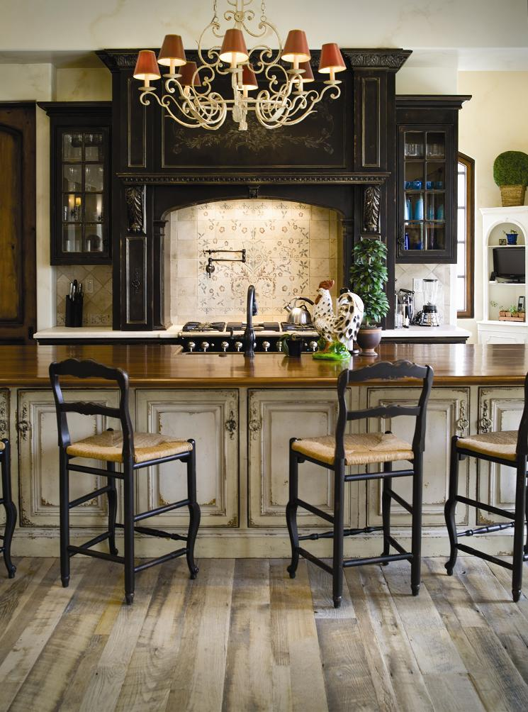 This black cabinetry is accented with gray heavily distressed island