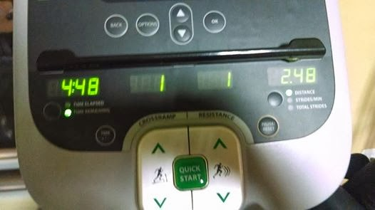 picture of an elliptical machine with stats on activity