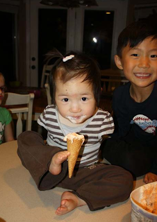 chinese child eats an ice with bone