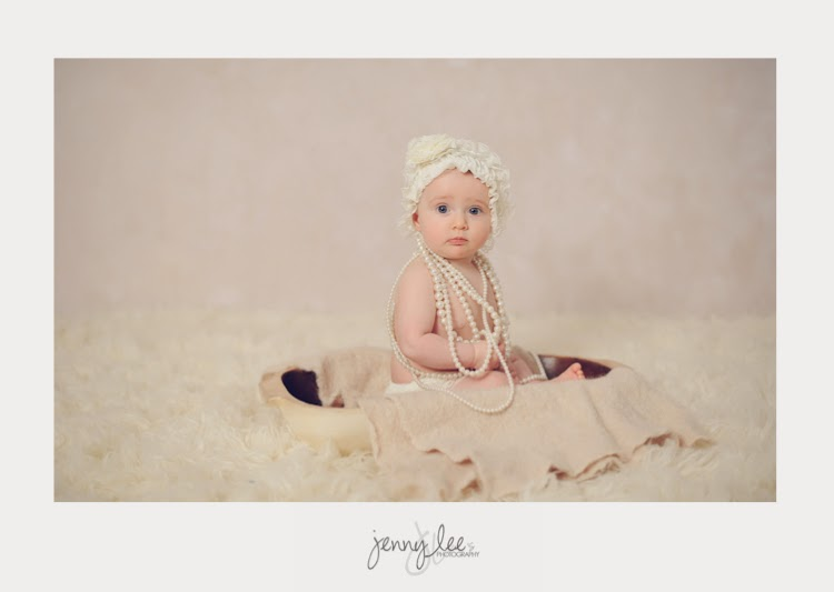 A baby girl in lace and pearls for her in studio creative session.