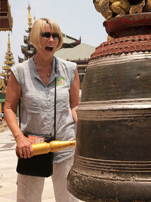 Ringing the bell - Schwedagon temple, Rangoon