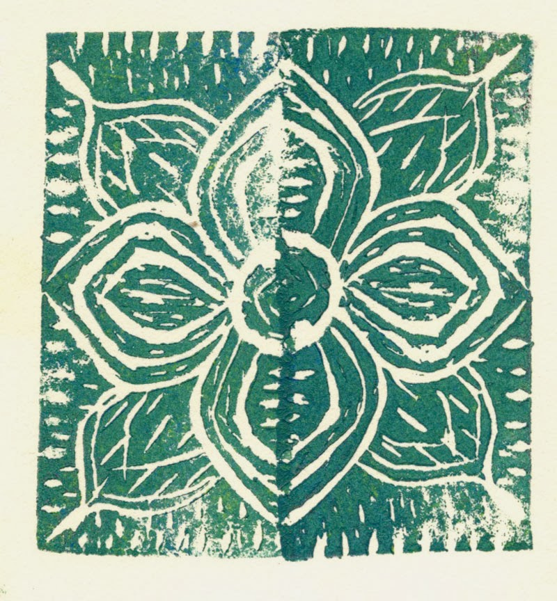 Mirror image stamp of flower
