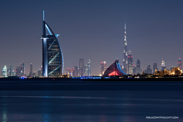 Photo of Burj Al Arab hotel and Burj Khalifa in the background as seen from the palm island