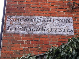 Ghost sign for SimpsonSampson Licensed Maltster, Farnham, Surrey