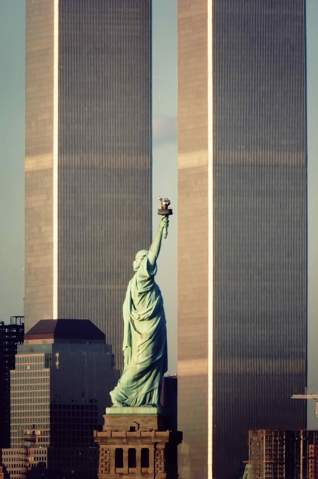 The Statue of Liberty, flanked by the twin towers of the World Trade Center, New York, USA, 1983.