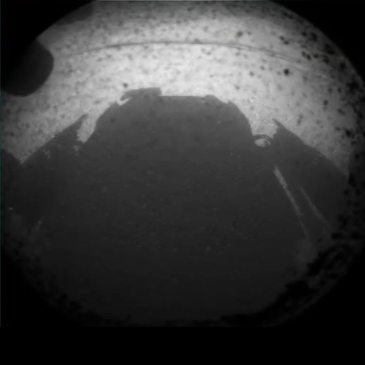 Curiosity MSL lands on Mars. Curiosity camera showing the shadow of the rover on Martian ground. 6 August 2012. NASA/JPL.