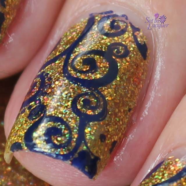 Stamped nail art using KBShimmer Sun & Games and Fab Ur Nails image plate
