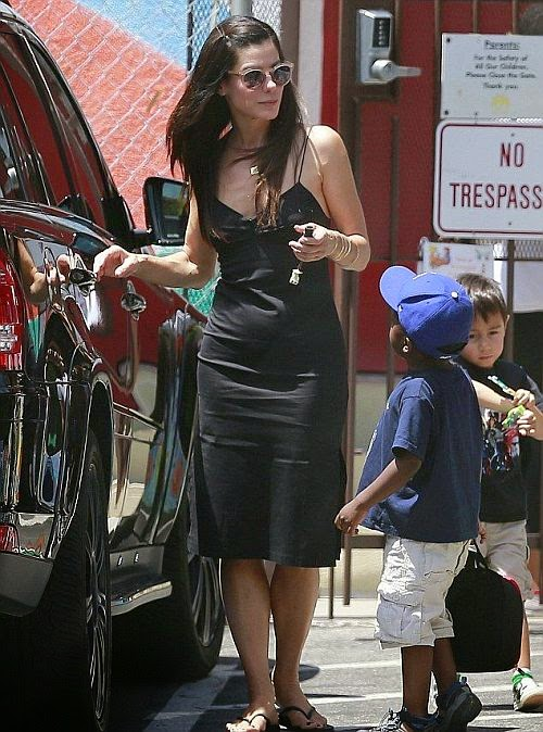 The actress - who turn 50 on July 26 was wearing an incredible signature of sparkly black long dress as she picked up her step son, Louis from school in Los Angeles on Friday, July 18, 2014.