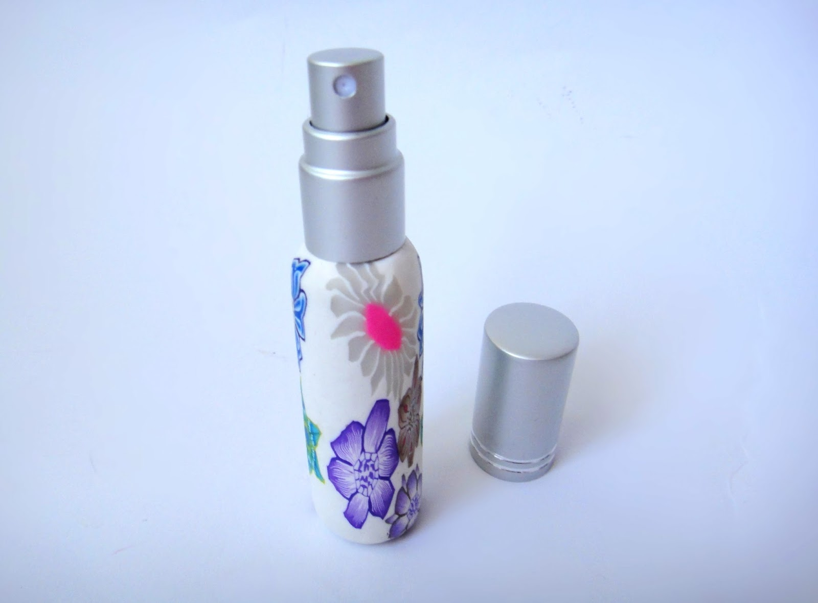 http://www.bornprettystore.com/10ml-floral-portable-perfume-bottle-spray-refillable-bottlerandom-color-p-16039.html