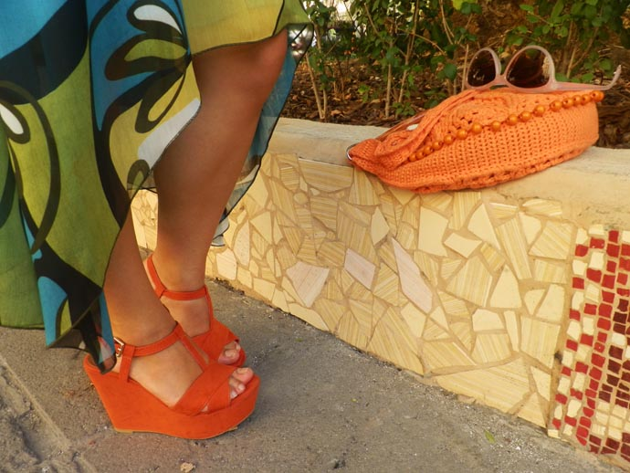 Outfit I am wearing: Soft green printed summer dress made by my mother and borrowed from her closet, orange Zara wedges, Orange handmade knitted purse, orange belt from Berska, Golden cuff from H&M and light pink cat eye sunglasses from H&M, golden earrings from Six accessories