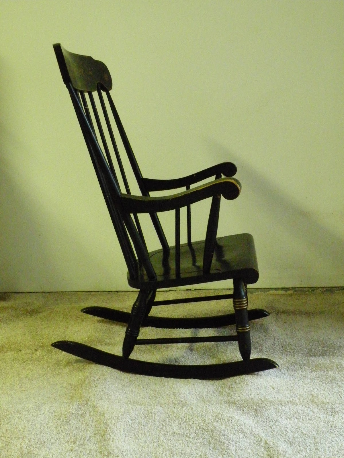 A reproduction antique rocking chair with the word