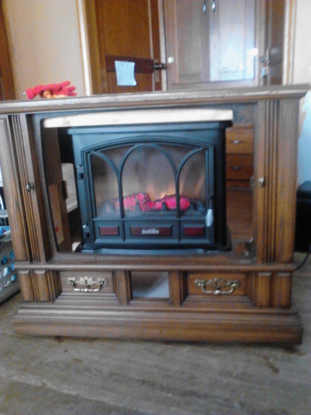 My repurpose old tv console to fireplace media center