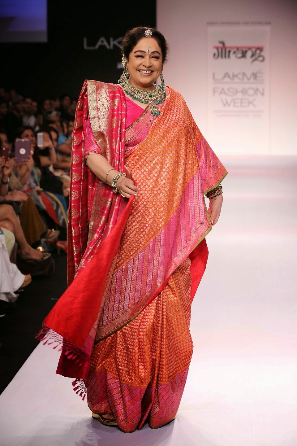 To end the show Gaurang had his favourite muse, the beautiful, elegant, dimpled Kirron Kher in a shocking pink brocade sari that glided down the ramp to thunderous applause.