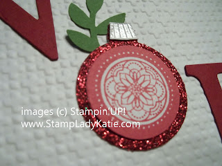 Christmas card made with the Big Shot alphabet die cuts and square lattice embossing folder