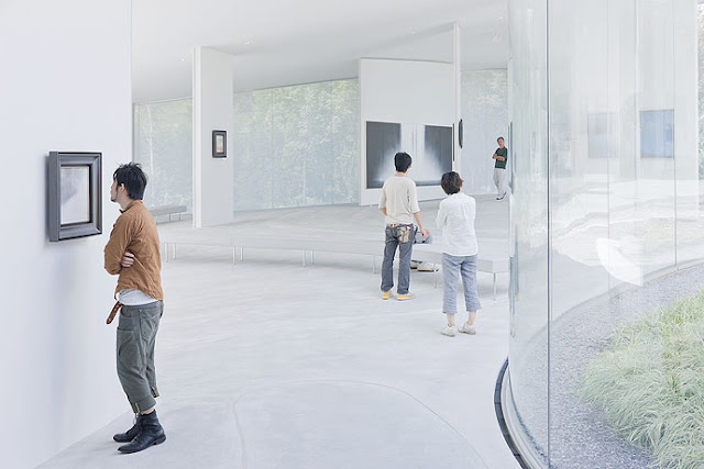 Photo of people observing the art inside of museum by the window