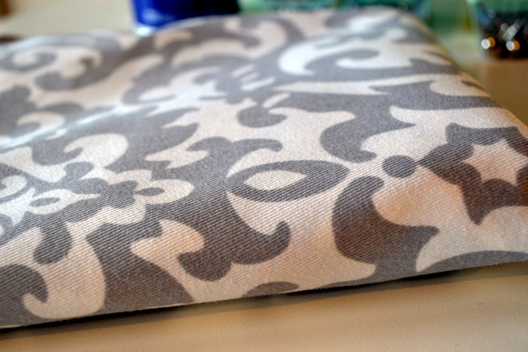 This gorgeous grey and white fabric updates the bench