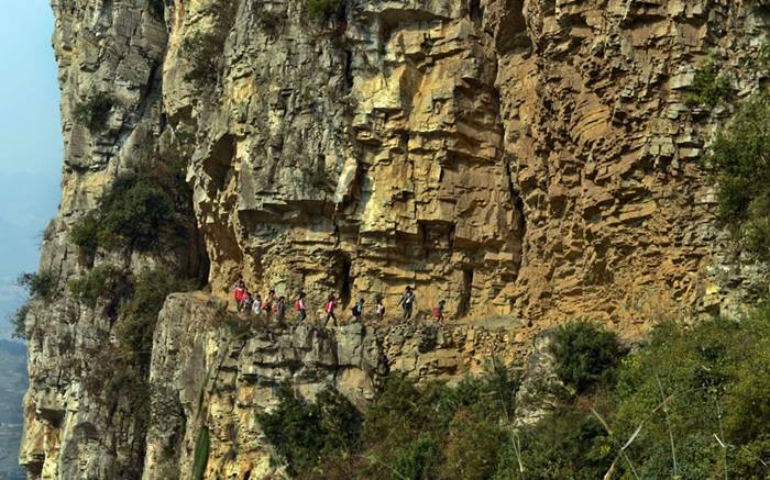 Children walk along a narrow mountain road to get to school in Bijie, southwest China's Guizhou Province. Banpo Elementary School is located halfway up a mountain and each day students from the nearby Genguan village have to climb a narrow winding footpath cut into the mountainside...Picture: HAP/Quirky China News / Rex Features