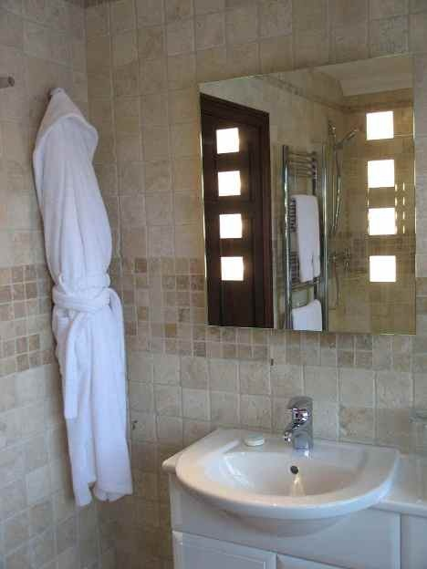 Modernos dise os de espejos para el ba o dise os de ba os for Espejos banos modernos