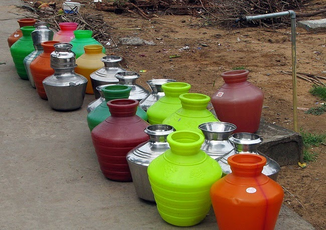 Water pots waiting to be filled from a street tap in Chennai, India. (Credit: McKay Savage via Wikimedia Commons) Click to Enlarge.