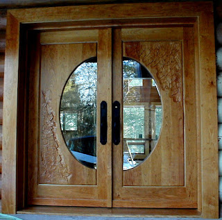 Cherry carved door by http://www.huismanconcepts.com/