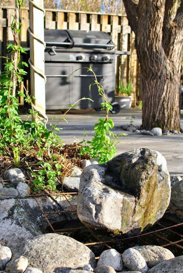stenfontän trädgård grillplats