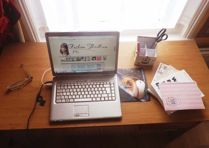 My desk: Laptop, mouse, glasses, books, scissors, pens