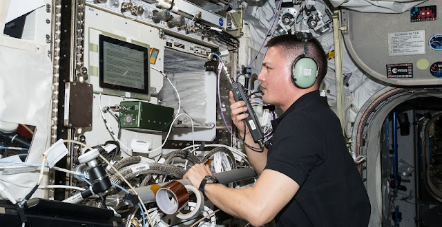 NASA astronaut Kjell Lindgren uses a HAM radio onboard the ISS to speak with operators down on Earth. Credit: NASA